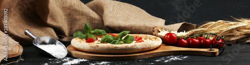 Fototapeta vegetarian italian Pizza with tomatoes, mozzarella cheese  and basil. Delicious italian pizza obraz