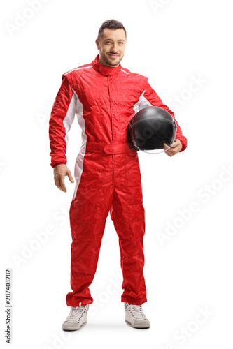 Canvas Print Racer in a red uniform holding a helmet and smiling