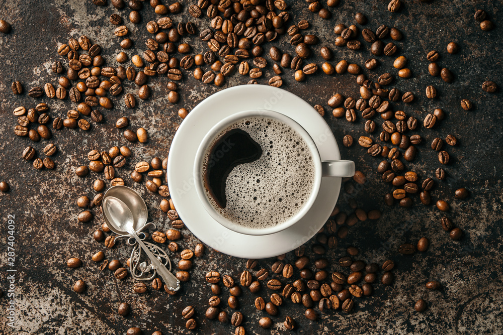 Fototapety, obrazy: Coffee cup and coffee beans on dark stone background. .