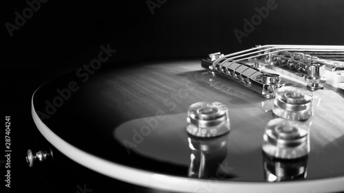 electric guitar . dark background . black and white . - 287404241