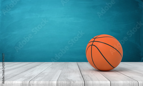 3d rendering of a basketball on wooden surface near blue wall. Tablou Canvas