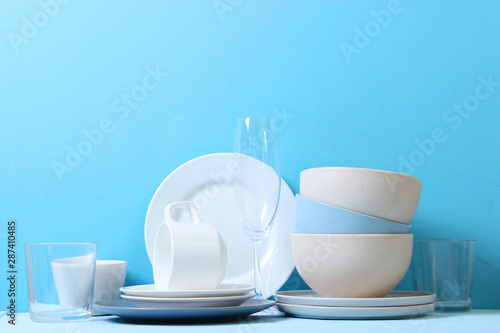 Valokuvatapetti A set of dishes and kitchen utensils on a colored background.