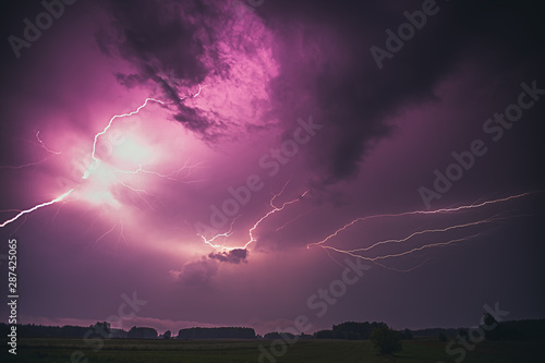 Fototapeta Lightning with dramatic clouds composite image