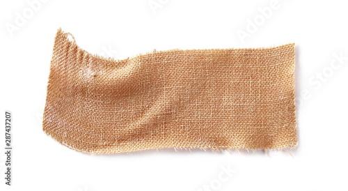 Valokuvatapetti Adhesive bandage isolated on white background, top view