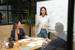 canvas print picture Female coach leader conference speaker give business presentation in boardroom
