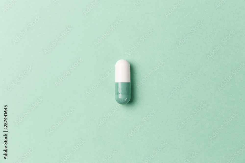 Fototapety, obrazy: Pharmaceutical medicine pills, tablets and capsules on mint background. Top view. Flat lay. Copy space. Medicine concepts. Minimalistic abstract concept. Neo mint color
