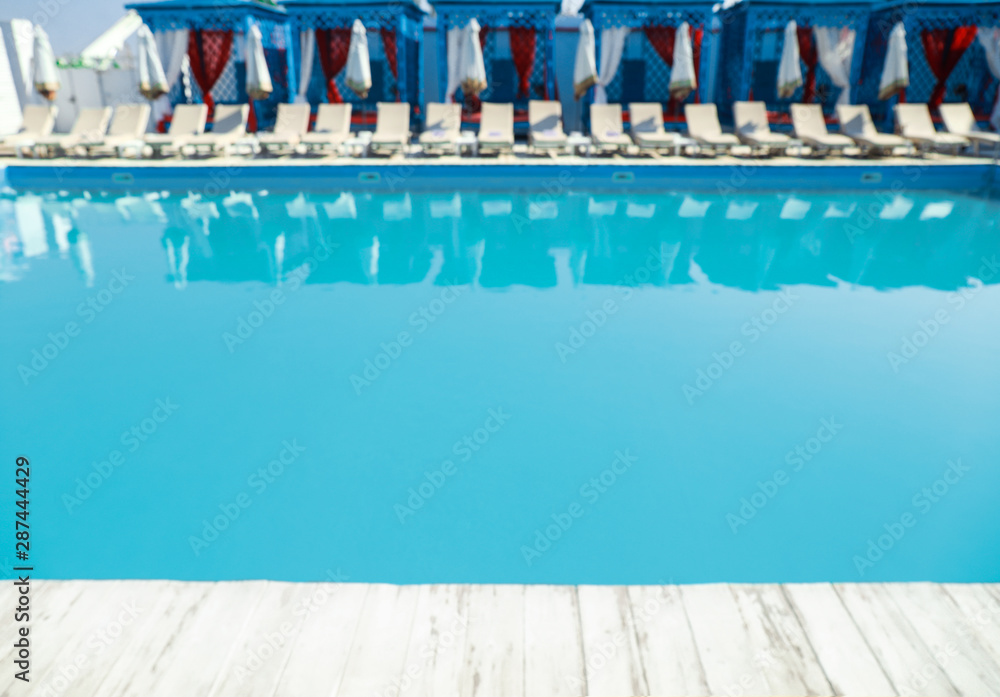 Obraz Blurred view of clean swimming pool on sunny day fototapeta, plakat