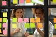canvas print picture Happy diverse businesswomen laugh talk check project progress on stickers