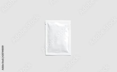 Fotografía  Blank white sachet packet mockup, isolated on gray background