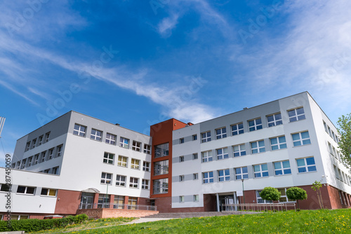 Public school building at sunny day, exterior view Fototapete
