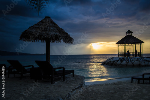 Fototapety, obrazy: Gazebo by the beach with colorful sunset