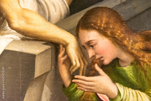 Fotografie, Obraz Detail of medieval painting showing Mary Magdalene kissing Jesus´s hand