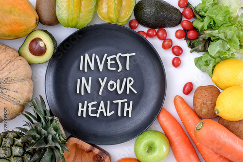 Fototapeta Invest in your health , Healthy lifestyle concept with diet and fitness , Get fit in  , fitness equipment and healthy food obraz