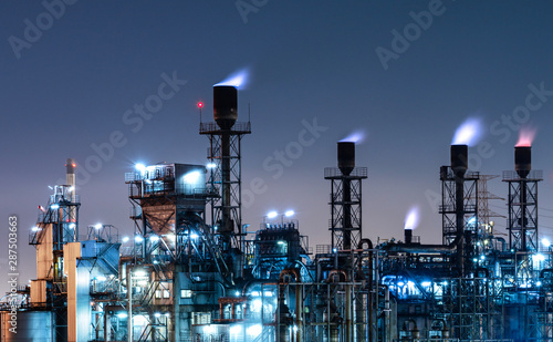 Fototapeta Industrial view oil and gas refinery,Detail of equipment oil pipeline steel at night background obraz