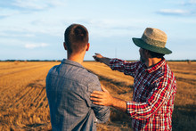Two Ranchers Talking Outdoors ...