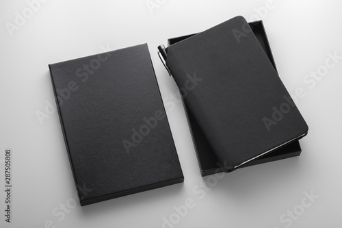 Fotografie, Obraz  Black pu leather notebook in box with pen holder, mockup on grey background, bus