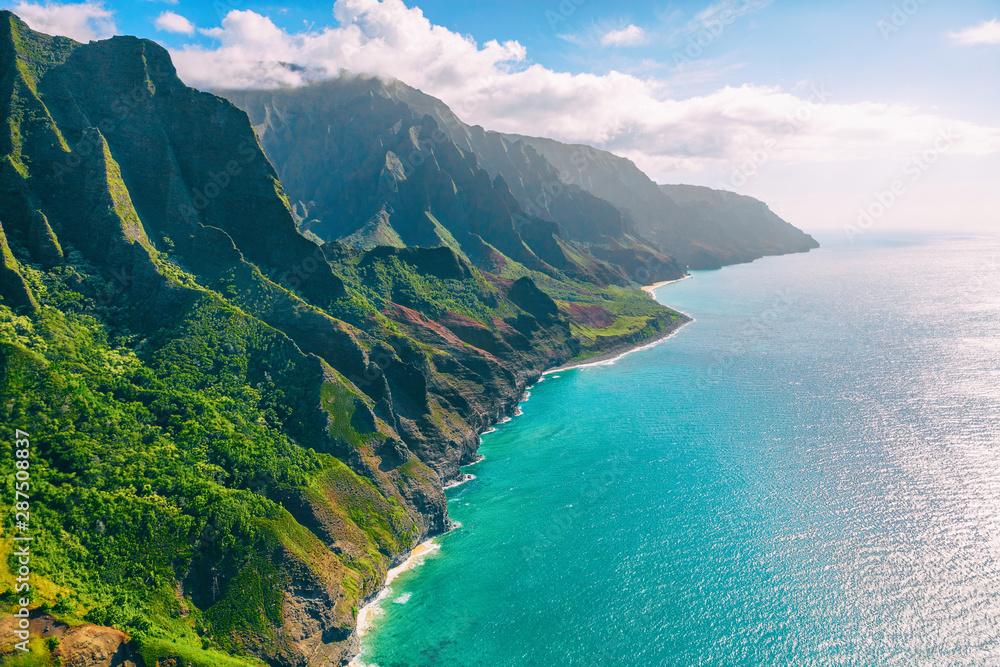 Fototapeta Hawaii Kauai lansdcape aerial view from the air helicopter flight. Amazing dramatic Na Pali coast of hawaiian island mountains, USA summer travel.