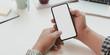Leinwanddruck Bild Close-up view of man holding blank screen smartphone in minimal office room