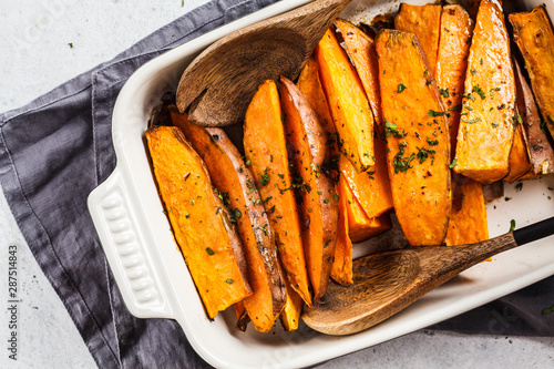 Baked sweet potato slices with spices in oven dish Wallpaper Mural
