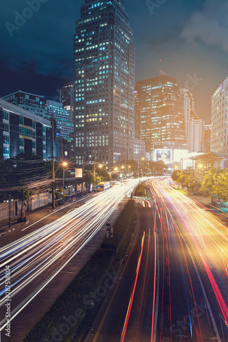 the light trails on the modern building background. Canvas Print
