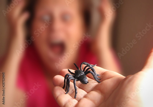 Spider in a hand, Arachnophobia Wallpaper Mural