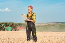 Farmer On The Wheat Field Doin...
