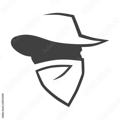 Fotografia Cowboy outlaw head symbol on white backdrop. Design element