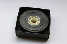 Small 35mm Movie Trailer Film Roll On A Bobby In A Box. This Is A 2-3 Minute Long Film Strip Shipped To A Movie Theatre