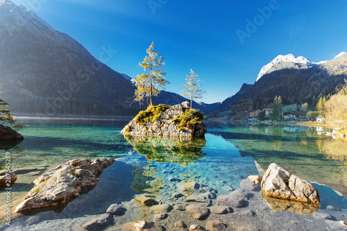 Foto auf Leinwand Grau Lake Hintersee in Germany, Bavaria, National Park Ramsau in Alps. Beautiful autumnal Alpine landscape, amazing light during sunrise. Incredible seasonal autumn scenery. Famous landmark in Germany.