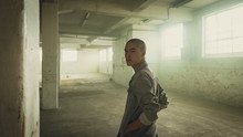 Portrait Of Young Man In Empty Warehouse
