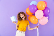 Image Of Beautiful Young Woman Celebrating Birthday With Multicolored Air Balloons And Present Box