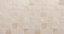 Old Retro Beige Ceramic Tile Texture Background. Beige Square Tiled Wall.