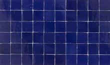 Old Retro Dark Blue Ceramic Tile Texture Background. Dark Blue Square Tiled Wall.
