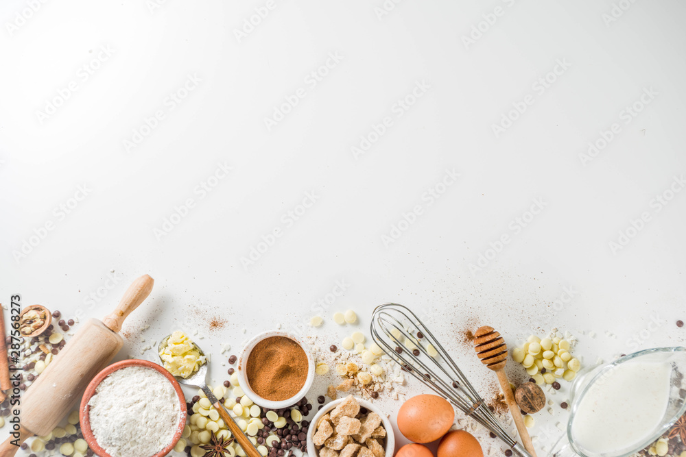 Fototapety, obrazy: Ingredients for autumn winter festive baking - flour, brown sugar, eggs, chocolate drops, butter, cinnamon on stone or concrete background.Top view copy space.