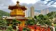 Leinwanddruck Bild Goldene Pagode in Park Nan Lian Garden mit Hochhäusern in Hongkong