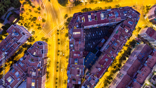Foto auf Gartenposter Barcelona Aerial Top view to night city buildings. Barcelona Spain. Yellow and purple. Drone art creative photo
