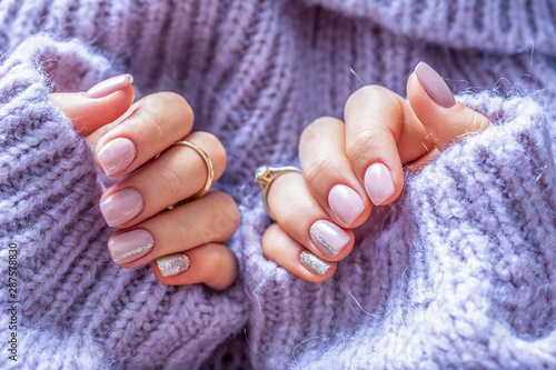Art nail manicure for bride in purple sweater Fototapeta