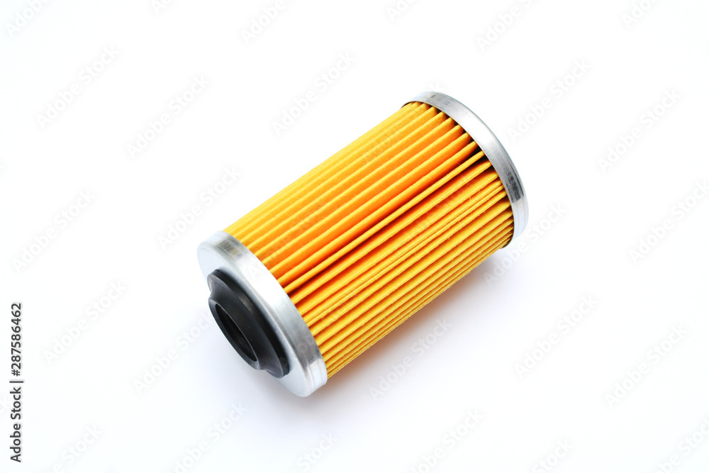 Fototapeta Replacement filter cartridge for cleaning oil of the car. Consumable. Engine oil filter isolated on white background.