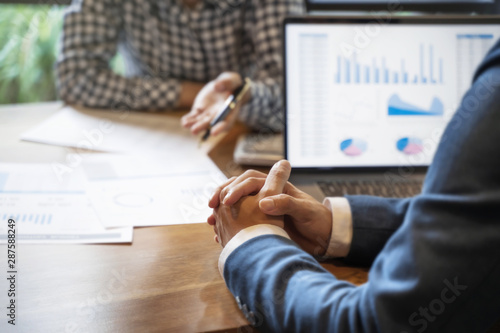 Obraz business people working in modern office calculating financial in company, problem and solution concept. - fototapety do salonu