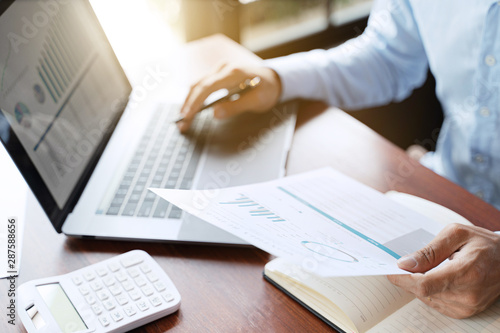 Cuadros en Lienzo  Financial analyst calculating with number documents, Investment concept