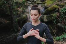 Young Woman Practicing Breathi...