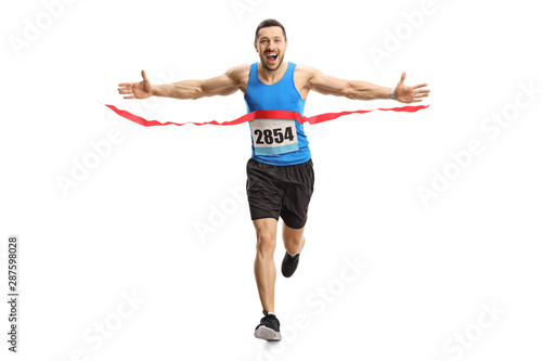 Fotografie, Obraz Happy young man finishing a marathon race on the finish line