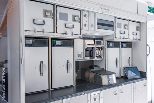Fotografija Preparing food for the passengers in the empty kitchen inside airplane