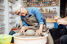 Senior Woman Spinning Clay On ...