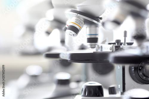 Fotografia  Set of microscopes standing in row in school chemist classroom