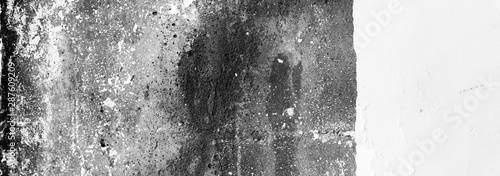 Black and white empty grunge dirty brush stroke concrete wall.