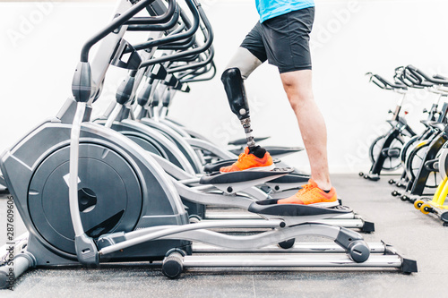 Disabled athlete with leg prosthesis training at the gym Wallpaper Mural