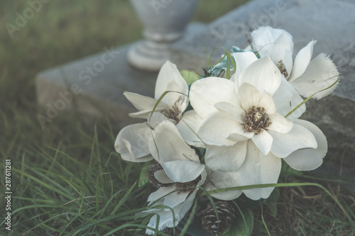 Photo All Saints day -  artificial flowers on an old grave