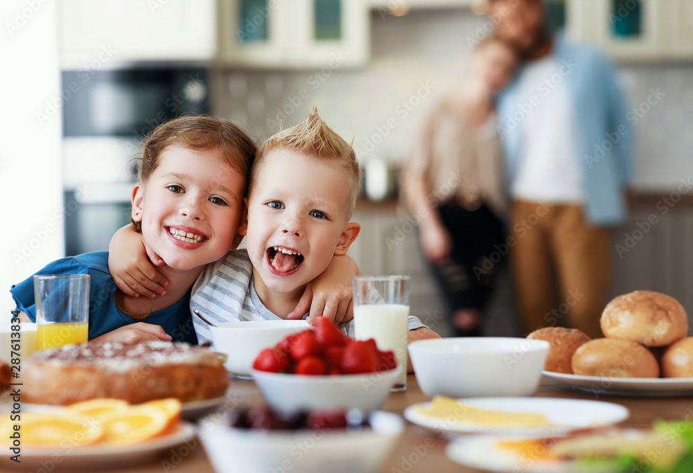 Fototapety, obrazy: family mother father and children have Breakfast in kitchen in morning.