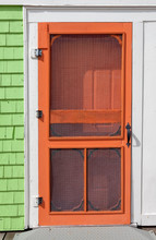 Old-fashioned Wooden Screen Door Painted Bright Orange.